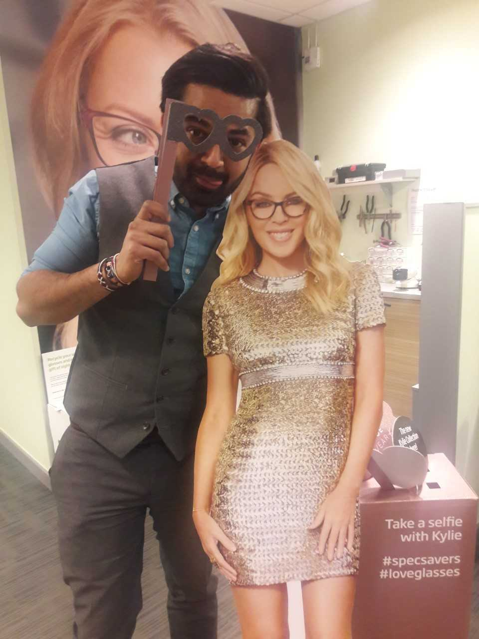 Optician Dharmesh Patel with Kylie at the Newport store.