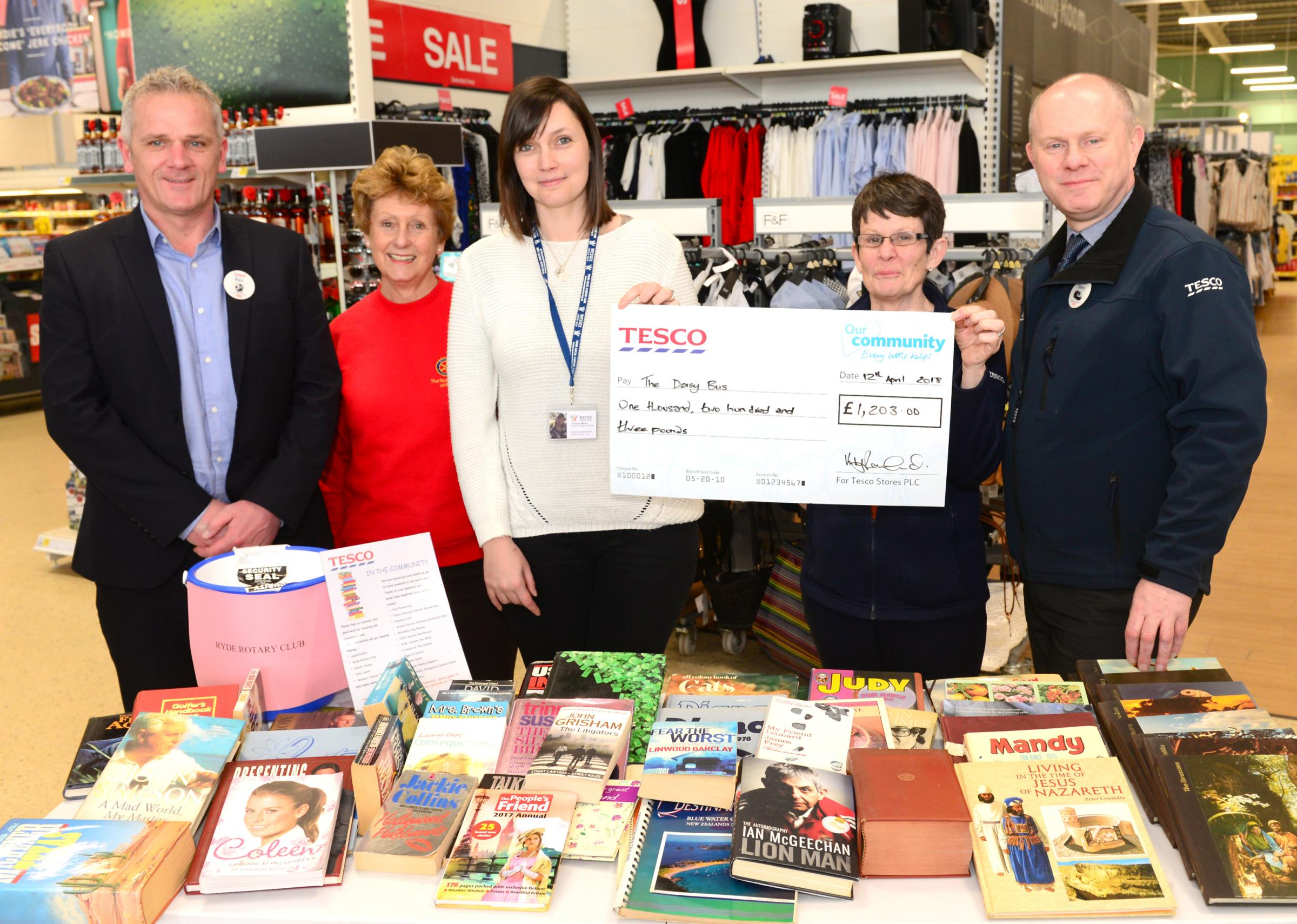 Store Manager Keith Rowland, President of the Ryde Rotary Club Beryl Ely, Lorraine White from Wessex Cancer Trust, Tesco Community Champion.
