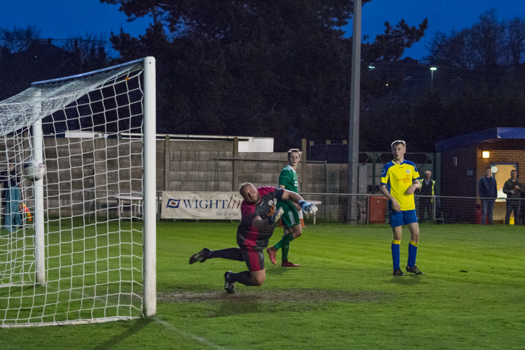 Newport keeper Gary Streeter unable to stop a first half volley from Brockenhurst.  Photo: Simon Dear