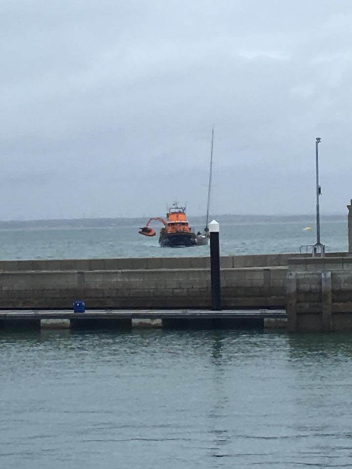 The Yarmouth RNLI Lifeboat, with the yacht alongside, arriving at Cowes. Picture posted by the Cowes RNLI on Facebook.