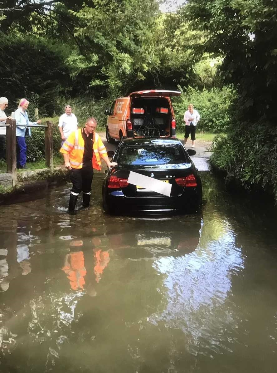 Car being recovered after getting stuck in Froglands Ford, Carisbrooke.