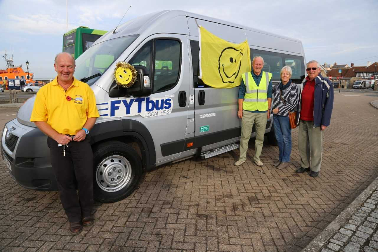 The new FYT Bus arrives on Yarmouth Quay. Front: Steve Fairclough, Deputy Operations Manager; back FYT Bus co-founders: Adrian Harris and Michael Craig either side of Freshwater Parish Council Chair, Gill Kennett. Picture: Alan Benns